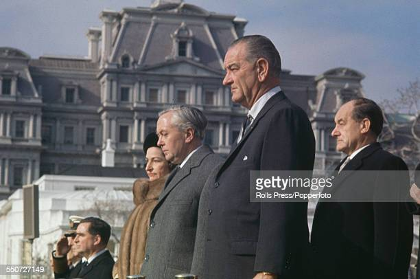 President of the United States Lyndon B Johnson stands with Prime Minister of the United Kingdom Harold Wilson during the playing of national anthems...