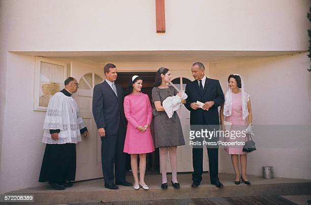President of the United States Lyndon Baines Johnson pictured with his wife Lady Bird Johnson at the christening of their grandson Patrick in...