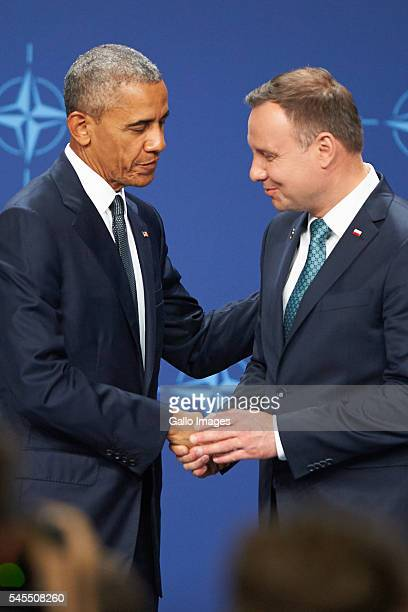 President of the United States of America Barack Obama and President of Poland Andrzej Duda shake hands during press conference during the NATO...