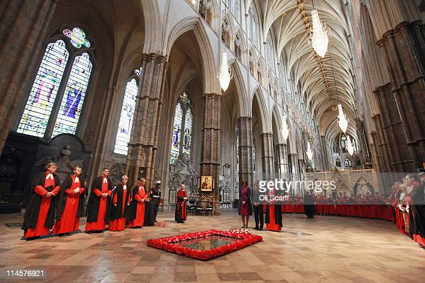 President of the United States of America, Barack Obama, the first lady, Michelle Obama, and the Dean of Westminster Abbey, John Hall, pay their...