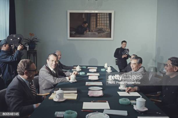 President of the United States, Richard Nixon pictured 2nd from left with National Security Advisor Henry Kissinger as they meet for talks with Zhou...