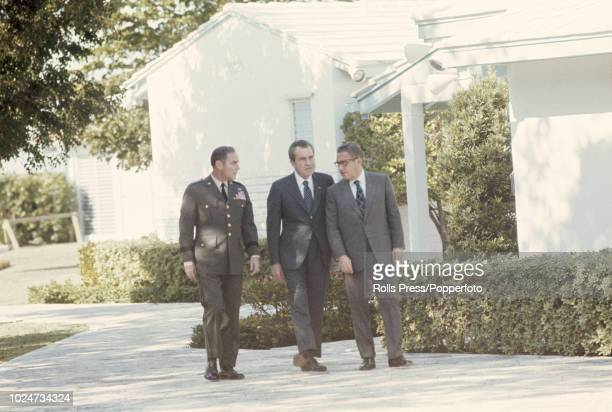 President of the United States Richard Nixon pictured in centre with National Security Advisor Henry Kissinger and Alexander Haig Vice Chief of Staff...