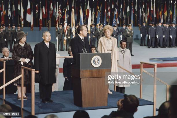 President of the United States Richard Nixon pictured speaking at a lectern as he welcomes Emperor Hirohito of Japan and Empress Nagako during a stop...