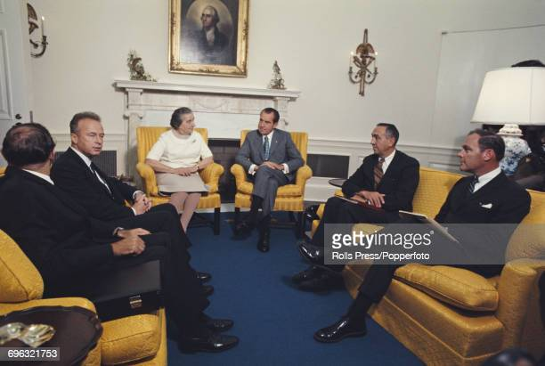 President of the United States Richard Nixon sits with Prime Minister of Israel Golda Meir State Department negotiator Joseph J Sisco and Deputy...