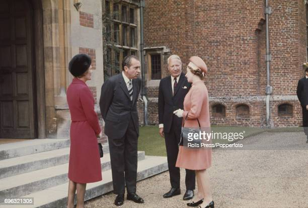 President of the United States Richard Nixon talks informally with Queen Elizabeth II as Pat Nixon and Prime Minister of the United Kingdom Edward...