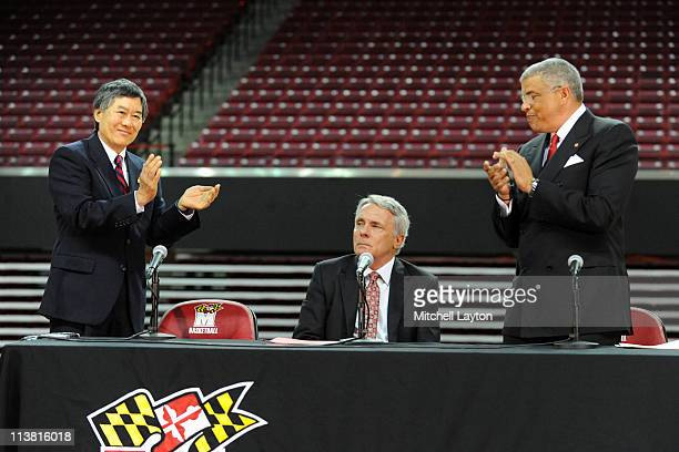 President of the University of Maryland Wallace D Loh and Athletic Director Kevin Anderson applaud basketball coach Gary WIlliams during the...