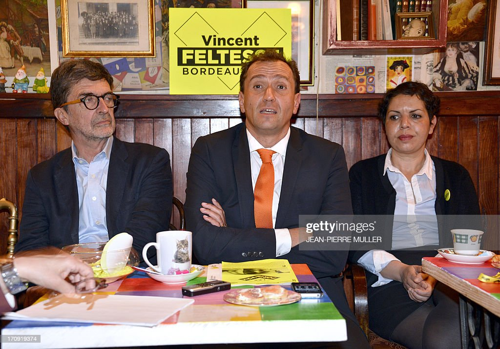 President of the Urban Community of Bordeaux (CUB) and Socialist Party candidate for the 2014 municipal elections Vincent Feltesse (C), flanked by his team members Olivier Bresse (L) and Naima Char...