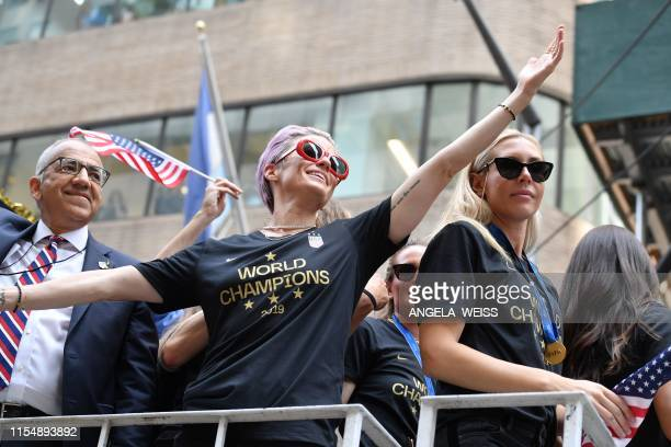 President of the USA Soccer Federation Carlos Cordeiro Megan Rapinoe Alexandra Long and other members of the World Cupwinning US women's team take...