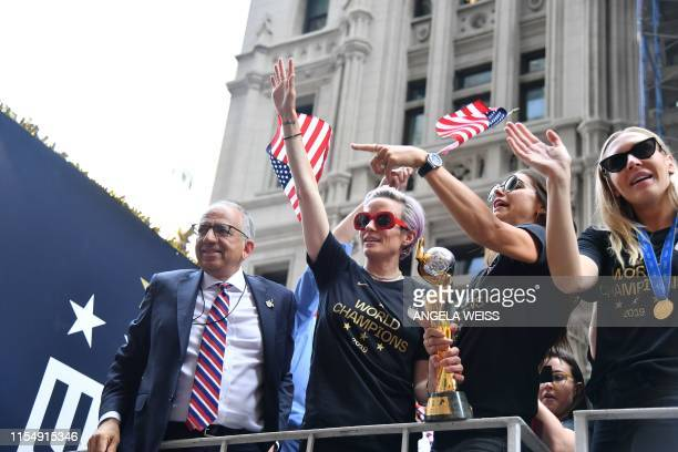 President of the USA Soccer Federation Carlos Cordeiro Megan Rapinoe Alex MorganAllie Long and other members of the World Cupwinning US women's team...