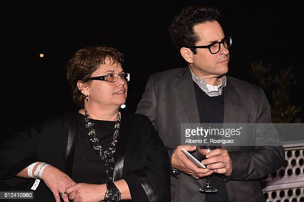 President of the USIreland Alliance Trina Vargo and director JJ Abrams attend the Oscar Wilde Awards at Bad Robot on February 25 2016 in Santa Monica...