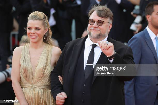 President of the Venezia 75 competition Jury director Guillermo del Toro and screenwriter Kim Morgan walk the red carpet ahead of the opening...
