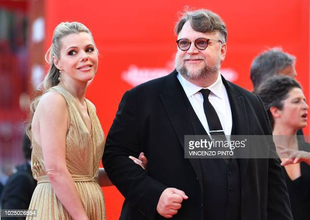 President of the Venezia 75 competition Jury Mexican director Guillermo del Toro and screenwriter Kim Morgan arrive for the opening ceremony and the...