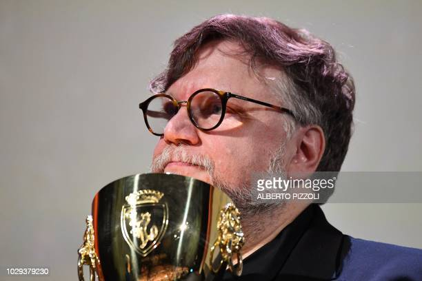 President of the Venezia 75 competition Jury, Mexican director Guillermo del Toro holds the Coppa Volpi for Best Actor during the awards ceremony of...