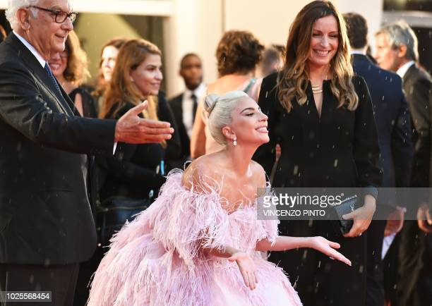 President of the Venice Biennale Paolo Baratta greets singer and actress Lady Gaga arrives for the premiere of the film A Star is Born presented out...