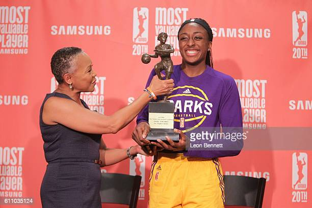 President of the WNBA Lisa Borders gives Nneka Ogwumike of the Los Angeles Sparks her 2016 WNBA MVP Award at Walter Pyramid on September 28 2016 in...