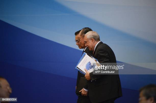 President of the World Bank Jim Yong Kim Chinese Premier Li Keqiang and secretarygeneral of the Organisation of Economic Cooperation and Development...