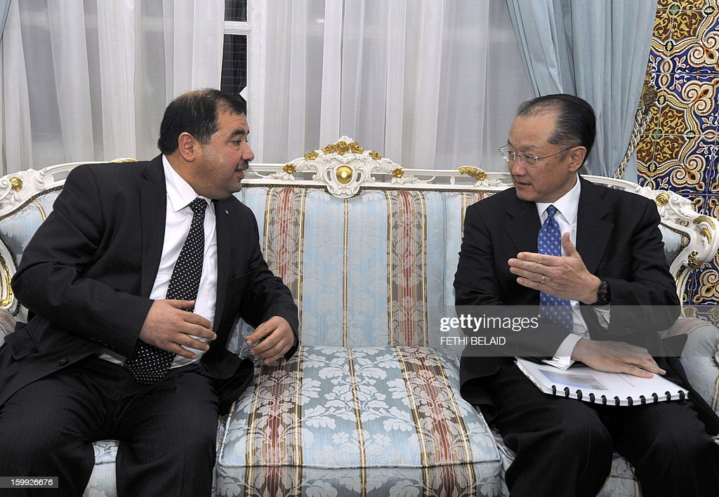 President of the World Bank Jim Yong Kim (R) meets Tunisian Investisment and International Cooperation Minister Riadh Bettaieb (L) on January 23, 2013 in Tunis. Kim is on 2 day official visit to Tunisia to discuss boosting economic growth.