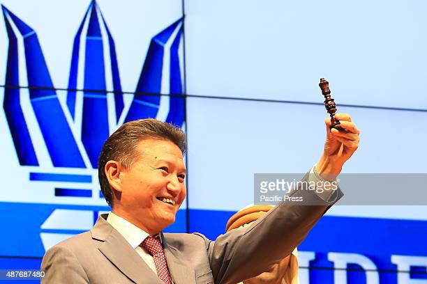 President of the World Chess Federation FIDE Kirsan Ilyumzhinov showing a black chess figure tomorrow the white figure will be the one to start first