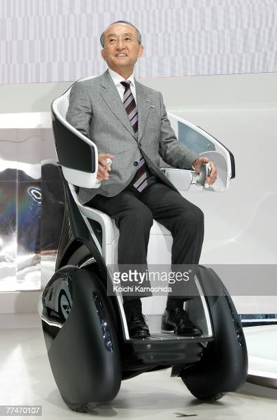 President of Toyota Motor Corp, Katsuaki Watanabe introduces the company's new vehicle, i-Real during the press day of the 40th Tokyo Motor Show at...
