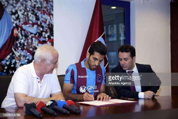 President of Trabzonspor Hayrettin Hacisalihoglu attends the signing ceremony of Trabzonspor's new transfer Iranian national player Vahid Amiri in...