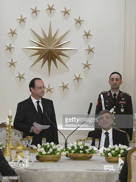 President of Turkey Abdullah Gul listens President of France Francois Hollande during the dinner at Cankaya Presidential Palace in Ankara Turkey on...