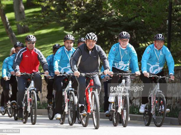 President of Turkey Abdullah Gul rides a bicycle with a group of cyclists ahead of the 50th Presidential Cycling Tour at the Cankaya Presidential...
