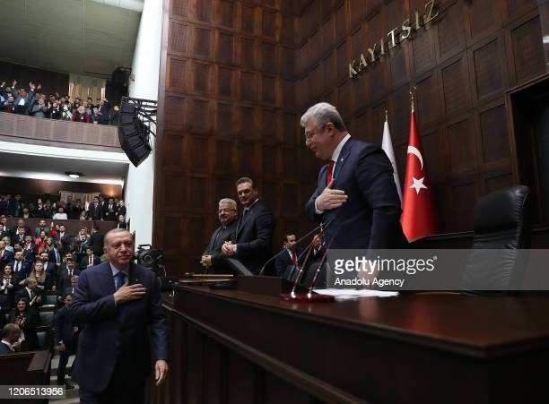 President of Turkey and leader of Justice and Development Party Recep Tayyip Erdogan greets as he attends his party's group meeting at Grand National...