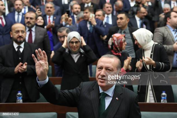 President of Turkey and Leader of the Justice and Development Party Recep Tayyip Erdogan waves after giving a speech during an AK party's group...