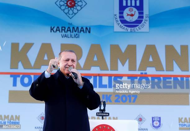 President of Turkey and Leader of the Justice and Development Party Recep Tayyip Erdogan gestures as he addresses during a mass opening ceremony at...