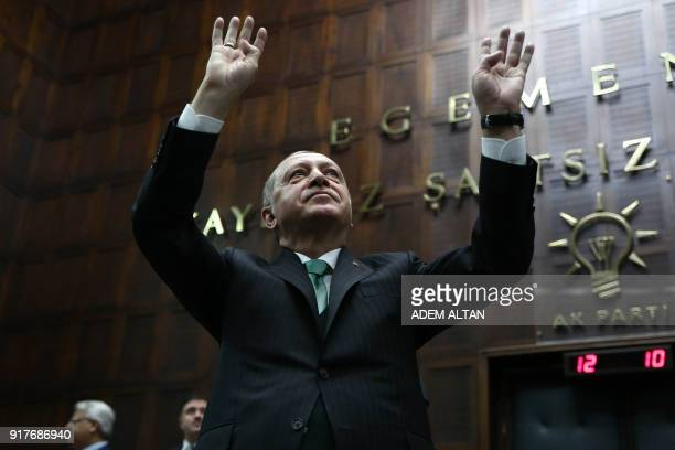 TOPSHOT President of Turkey and Leader of the Justice and Development Party Recep Tayyip Erdogan greets members of AK Party during AK Party's...