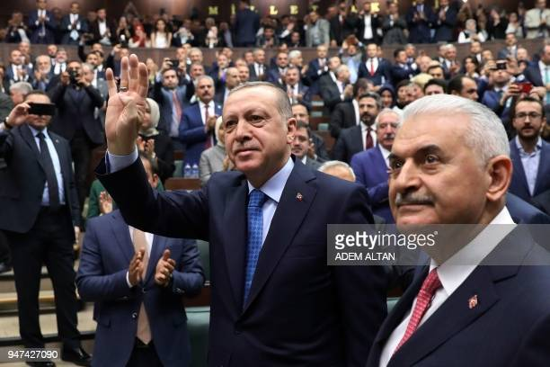 President of Turkey and Leader of the Justice and Development Party , Recep Tayyip Erdogan , waves as he arrives flanked by Prime Minister of Turkey...