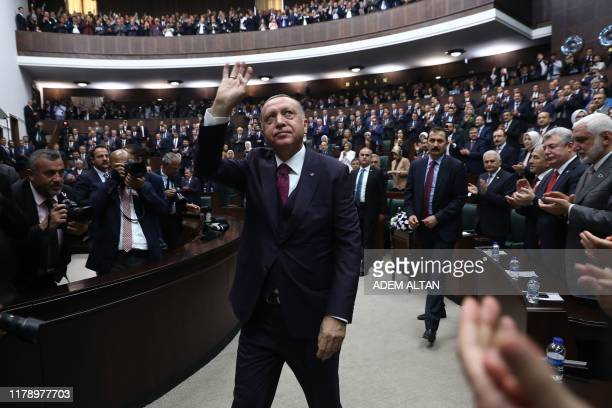 President of Turkey and leader of Turkey's ruling Justice and Development Party Recep Tayyip Erdogan waves to members of his party during AK's...