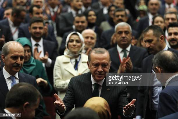 President of Turkey and ruling Justice and Development Party chair Recep Tayyip Erdogan gestures during the AK Party's extended provincial heads...