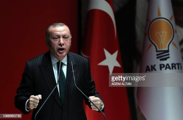 President of Turkey and ruling Justice and Development Party chairman Recep Tayyip Erdogan makes a speech during the AK Party's extended provincial...