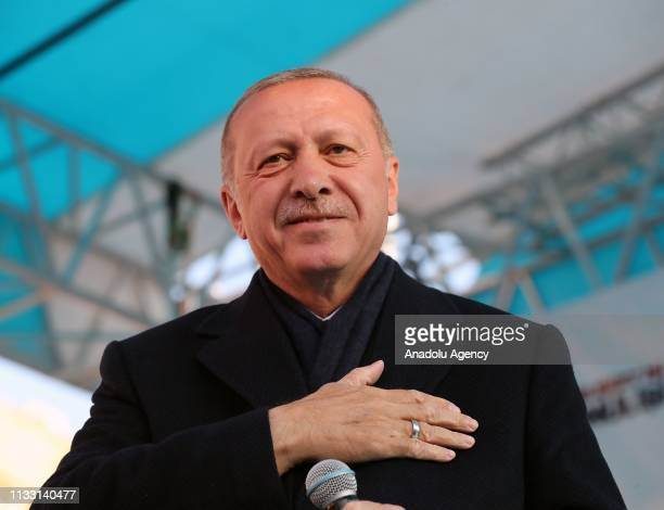 President of Turkey and the leader of Turkey's ruling Justice and Development Party Recep Tayyip Erdogan greets the crowd during a campaign rally...
