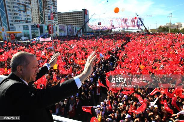 President of Turkey and the leader of Turkey's ruling Justice and Development Party Recep Tayyip Erdogan greets the crowd ahead of AK Party's 6th...