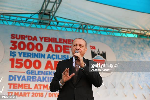 President of Turkey Recep Tayyip Erdogan addresses during the opening of 3000 renovated and reopened businesses and groundbreaking ceremony for the...
