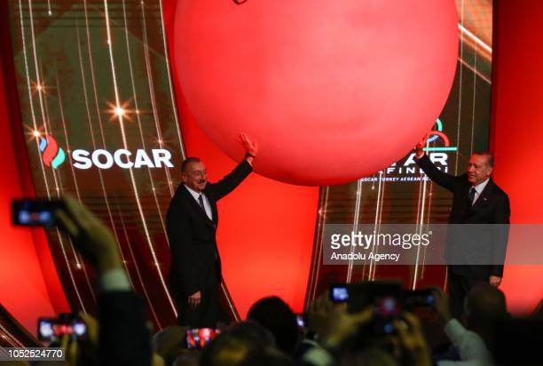 President of Turkey Recep Tayyip Erdogan and Azerbaijani President Ilham Aliyev touch the figure that represents 'drop of a petrol' to inaugurate the...