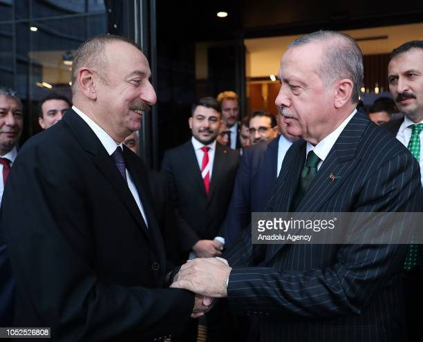 President of Turkey Recep Tayyip Erdogan and Azerbaijani President Ilham Aliyev greet each other after attending the opening ceremony of the SOCARs...