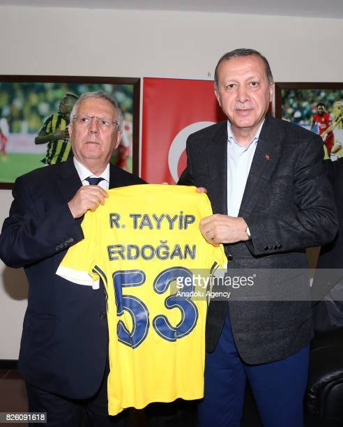 President of Turkey Recep Tayyip Erdogan and Chairman of Fenerbahce Aziz Yildirim pose for a photo with a jersey which is presented to Erdogan by...