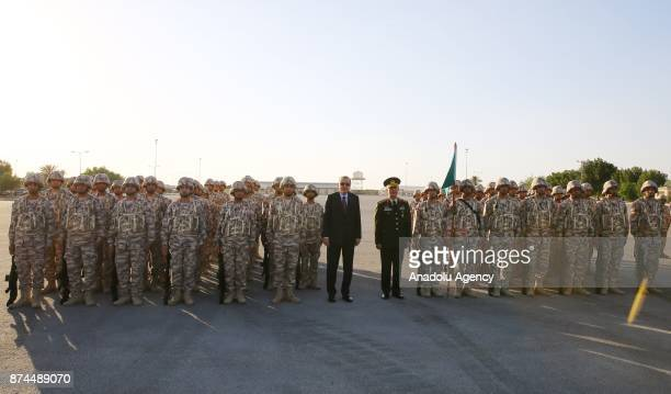 President of Turkey Recep Tayyip Erdogan and Chief of the General Staff of the Turkish Armed Forces Hulusi Akar pose for a photo with the soldiers at...