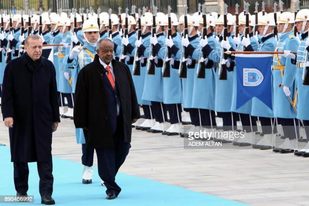 President of Turkey Recep Tayyip Erdogan and Djibouti's President Ismail Omar Guelleh review honor guards during a welcoming ceremony in Ankara on...