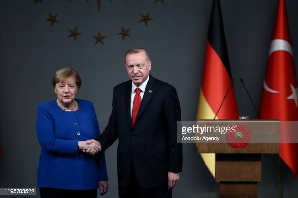 President of Turkey, Recep Tayyip Erdogan and German Chancellor Angela Merkel shake hands during a joint press conference at Vahdettin Mansion in...