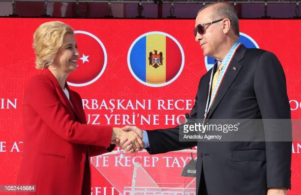 President of Turkey Recep Tayyip Erdogan and Governor of the Autonomous Territorial Unit of Gagauzia Irina Vlah shake hands after Vlah presented a...