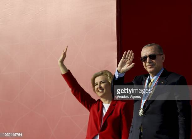 President of Turkey Recep Tayyip Erdogan and Governor of the Autonomous Territorial Unit of Gagauzia Irina Vlah greet people after Vlah presented a...