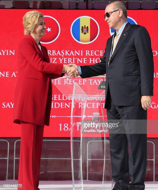 President of Turkey Recep Tayyip Erdogan and Governor of the Autonomous Territorial Unit of Gagauzia Irina Vlah shake their hands after Vlah...