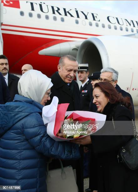 President of Turkey Recep Tayyip Erdogan and his wife Emine Erdogan are welcomed by French officials at Charles de Gaulle Airport in Paris France on...