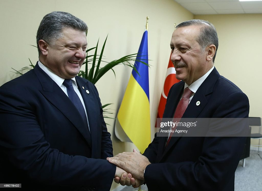President of Turkey Recep Tayyip Erdogan (R) and President of Ukraine Petro Poroshenko (L) shake hands during COP21, United Nations Conference on Climate Change, in Le Bourget, outside Paris, France, on November 30, 2015.