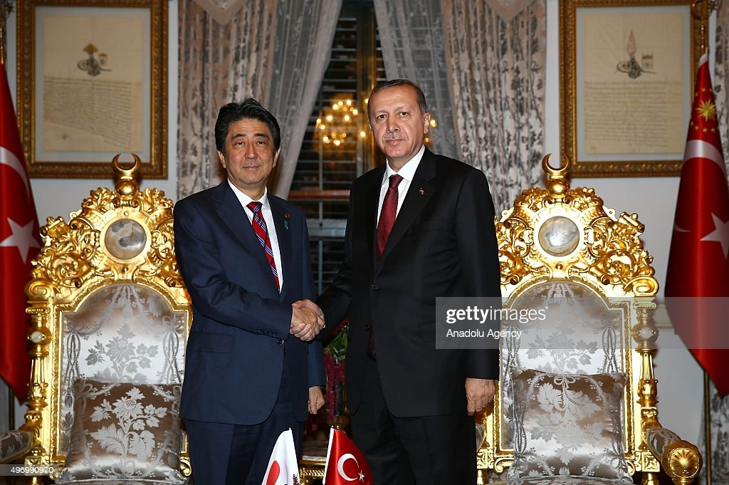President of Turkey Recep Tayyip Erdogan (R) and Shinzo Abe, Prime Minister of Japan (L) shake hands during their meeting at the Yildiz Palace State apartments in Istanbul, Turkey on November 13, 2015.