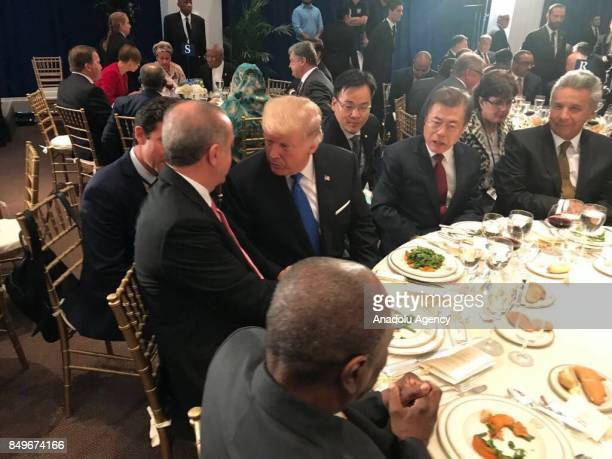 President of Turkey Recep Tayyip Erdogan and US President Donald Trump chat each other during a dinner hosted by United Nations Secretary General...